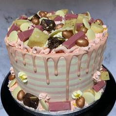 Pink drip stripe cake, Rose kitkats, rose gold eggs, blondies, milky bottons & glitter