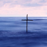 symbol of Baptism, a wooden cross in the