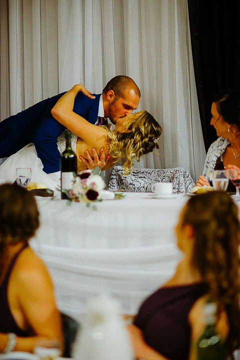 Newlywed Kiss during Speeches