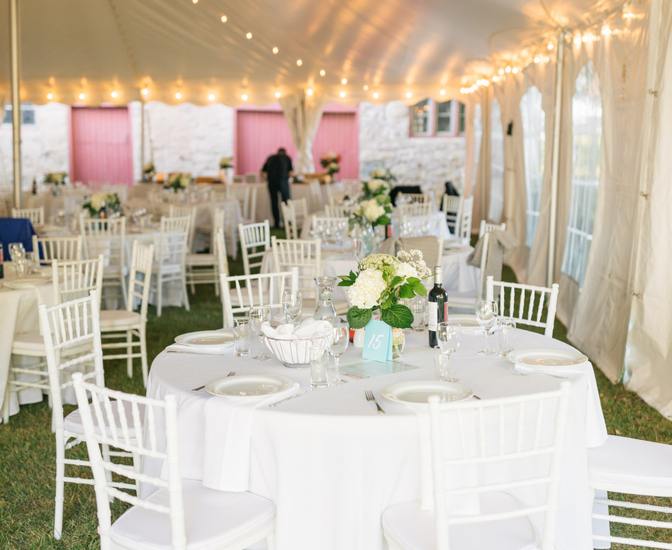Private property tented reception table with white and green centerpiece