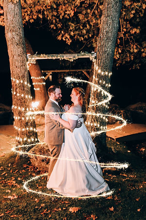 Photo of Bride & Groom posing in the dark with sparkler twinkle effects at  Intimate Outdoor Elopement Ceremony Ottawa Micro Wedding