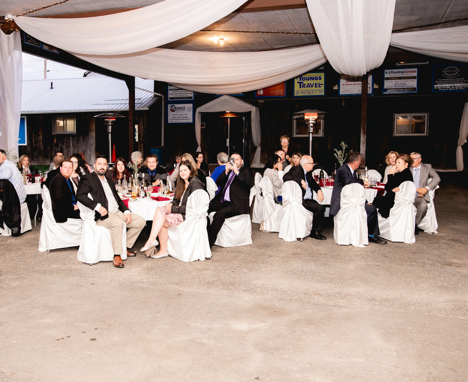 Wide shot of of Refined Rustic Glam reception space with white sheer ceiling drapery
