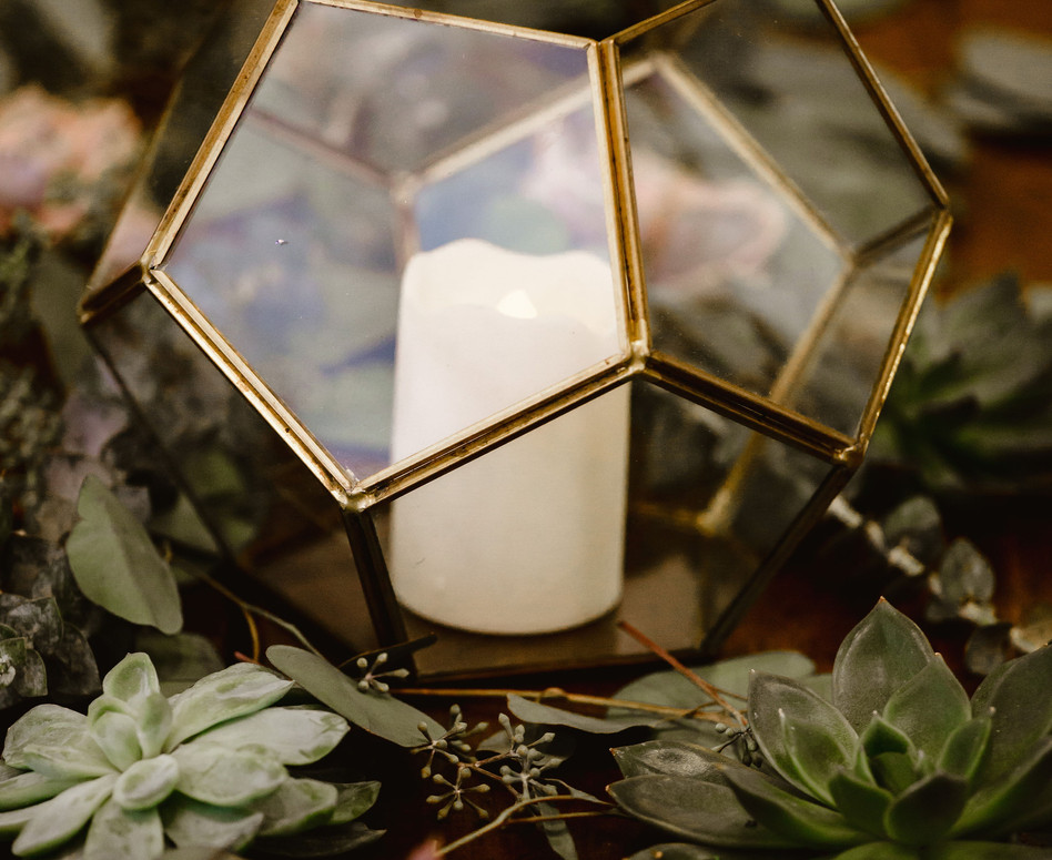 Close up detail shot of Gold Geometric candle holders and sprigs of dried lavender