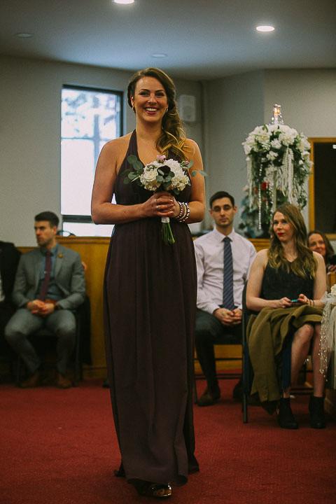 Bridesmaid walking down aisle at Wedding