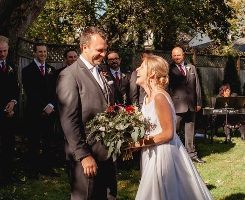 Bride and Groom laughing and smiling at each other during ceremony