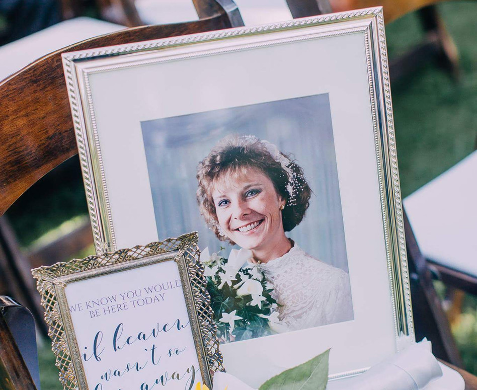 Memorial Sign, Photo Frame of Mother of the Bride with a single sunflower, sitting on ceremony chair