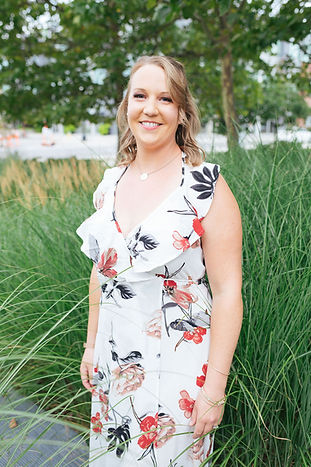 Wedding Planner, Amber Stemmler standing in front of long grass smiling