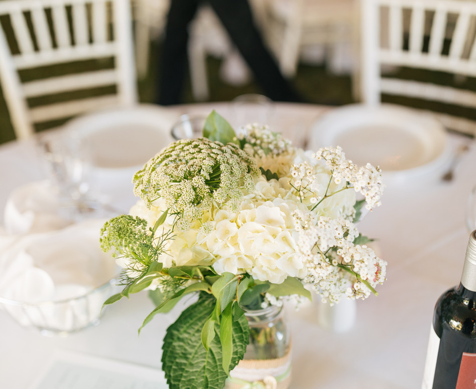 round table guest floral centerpiece white hydrangea with green