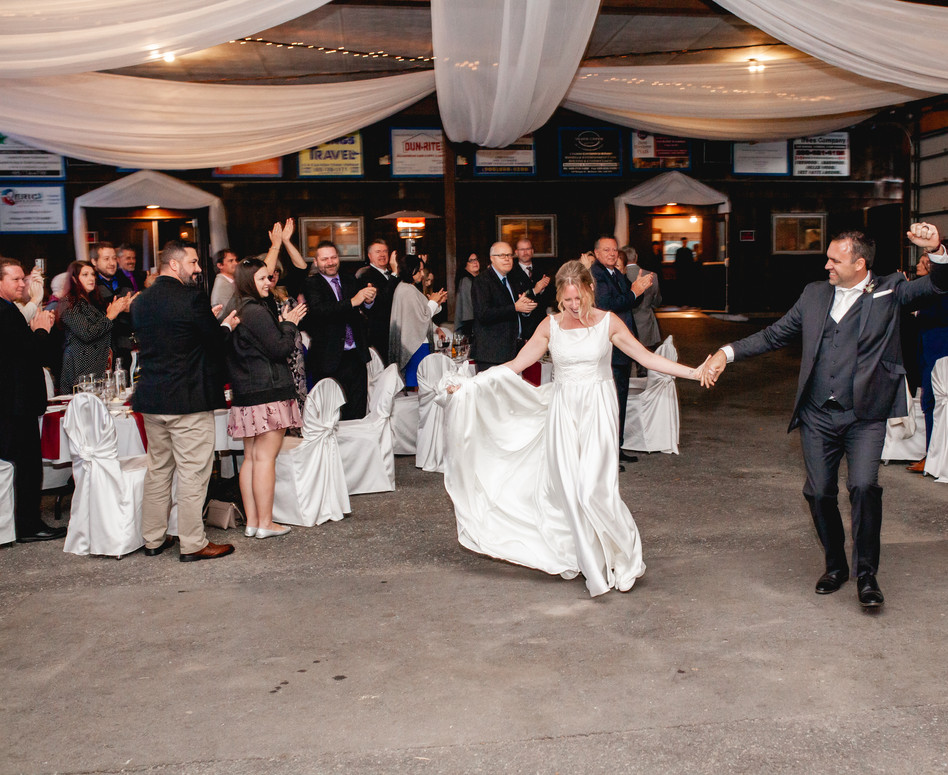 Bride and Groom doing their grand entrance into their Pavillion Reception