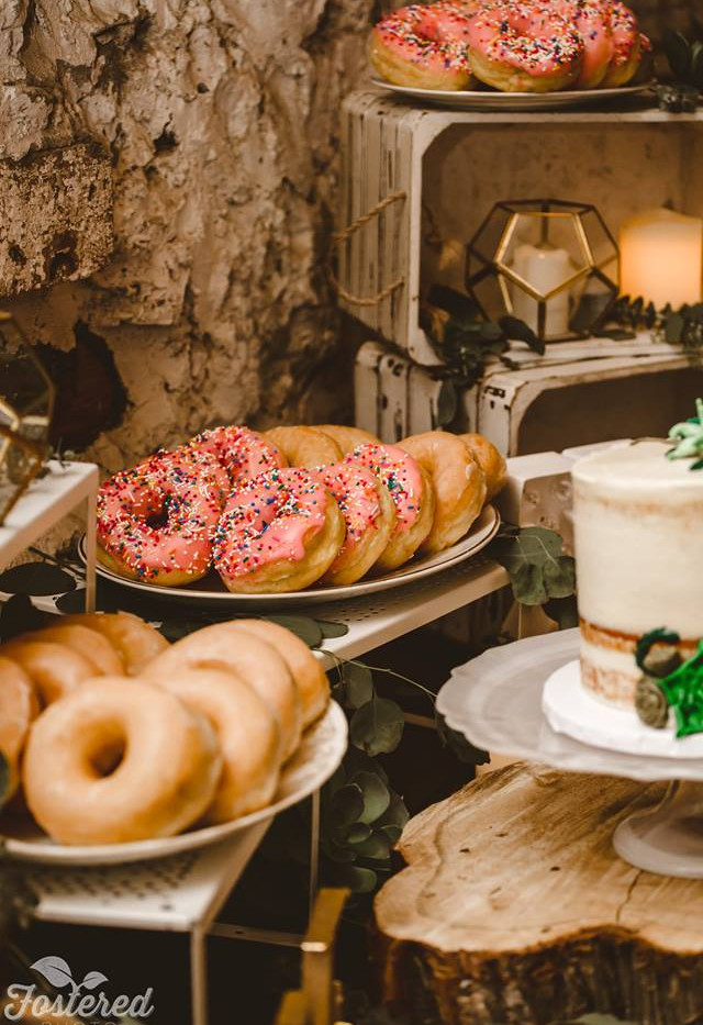 Close up of Donut Dessert Table with white wood crates, vintage and rustic platters