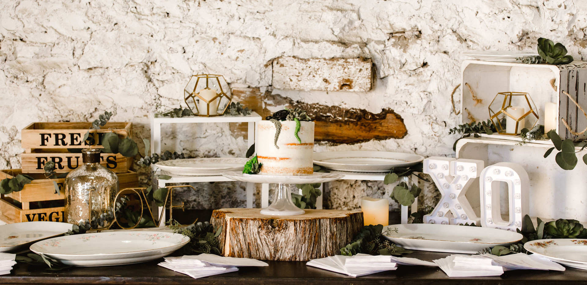 Wide Shot of Donut Dessert Table with white wood crates, vintage and rustic platters