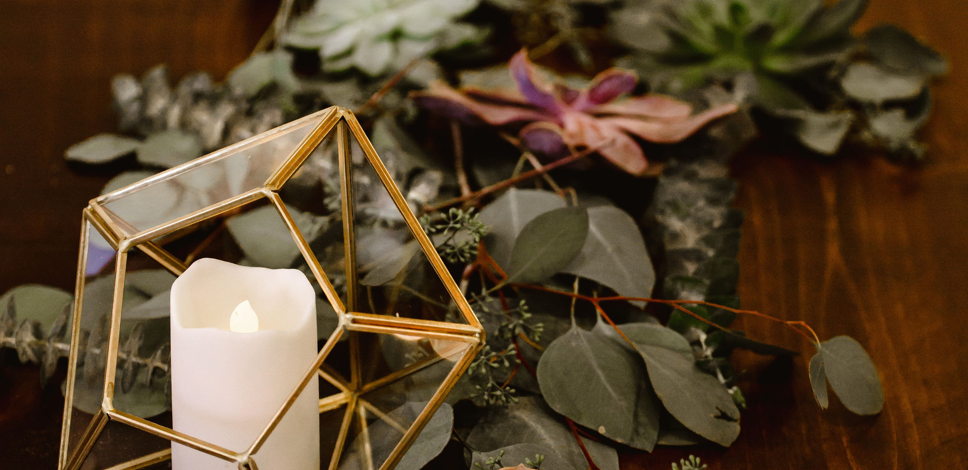 Eucalyptus and Succulent Greenery Table Runner with Gold Geometric candle holders and sprigs of dried lavender
