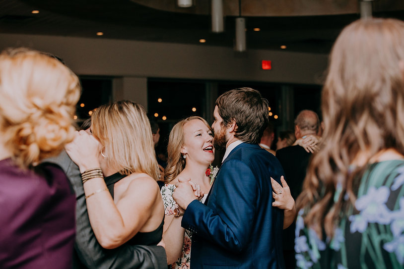 Wedding Planner, Amber Stemmler and her partner slow dancing at a Wedding Reception