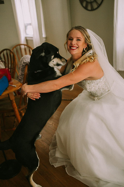 Bride posing with her dog during Bridal