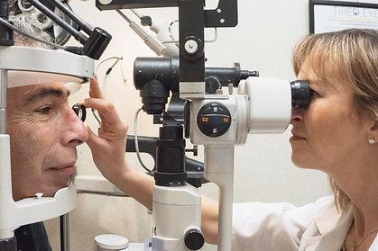 Dr Caruso examining patient