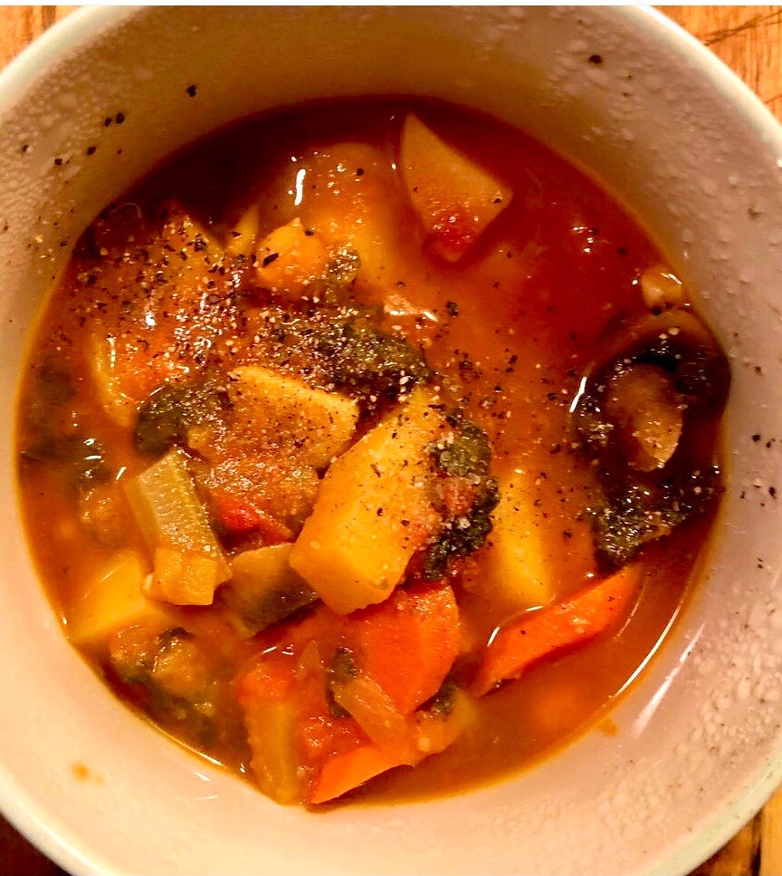 Rustic vegetable soup. Plant based soup. Vegetables in a bowl.