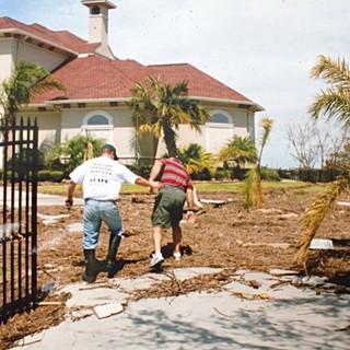 Owner Ben Peterek helping clean up after Hurricane Ike.