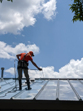 Spraying on Silicone Roofing Commercial Property.