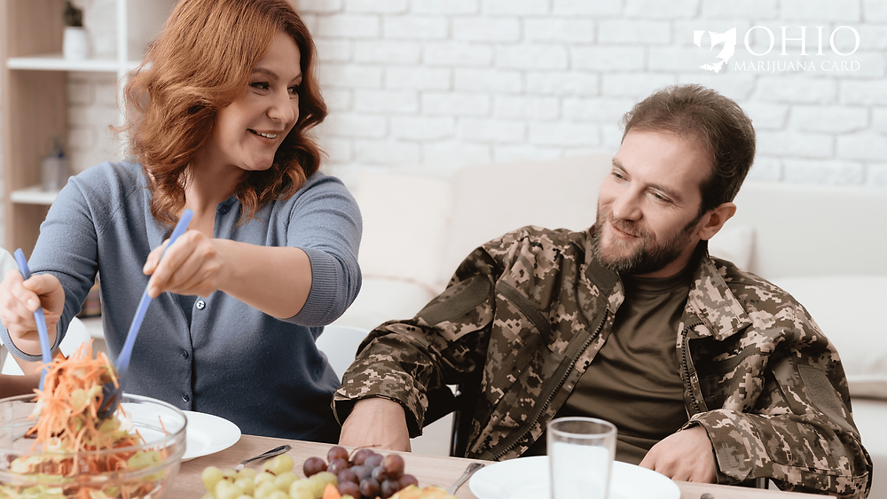 Woman is serving veteran food at dinner table