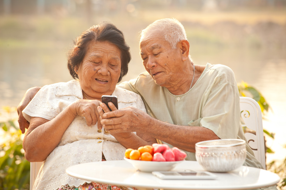 Elderly couple using a smartphone