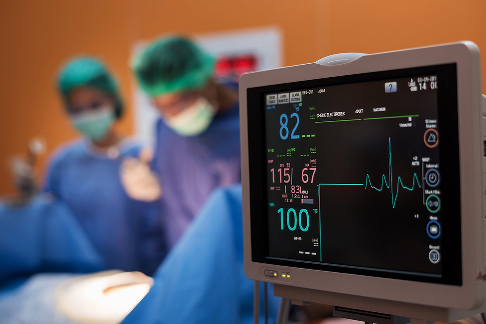 electocardiogram machine and medical staff