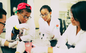 Black and brown students in science lab for STEM