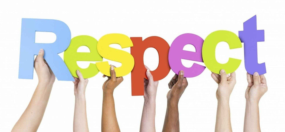 Hands holding up colored letters to spell  RESPECT