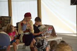 Group of kids enjoying a puppet show