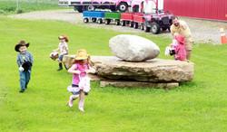 Kids on stick pony horse race