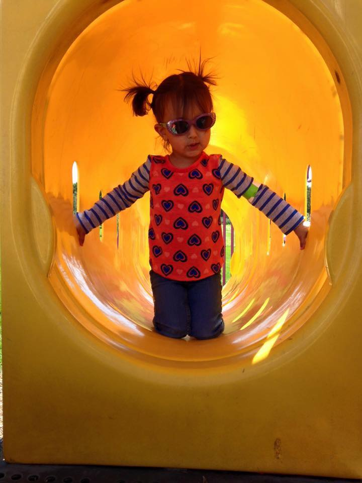 Girl in playground tunnel
