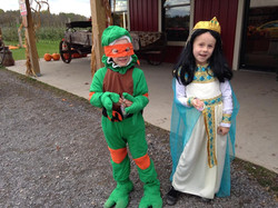 Two kids dresses up for event