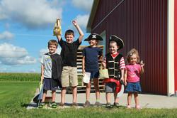 Group of kids posing as pirates