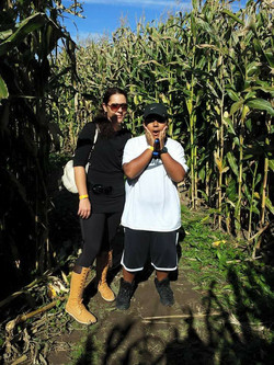 Two people in corn maze