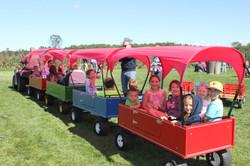 Children on little wagon ride