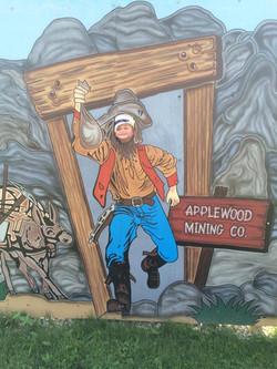 Boy posing in miner sign