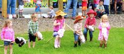 Children racing on pony sticks
