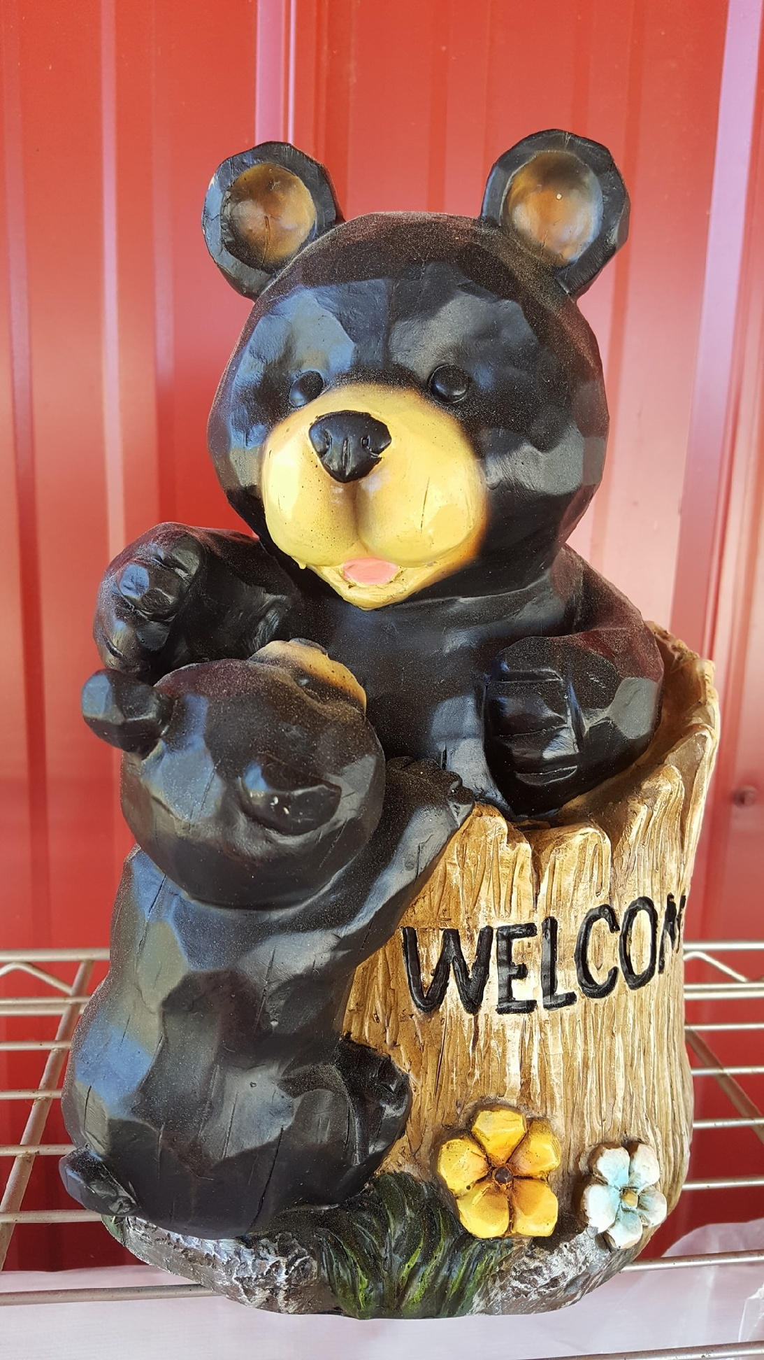 Welcome sign with bear statue