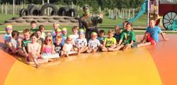 Group of kids posing w/ ninja turtle