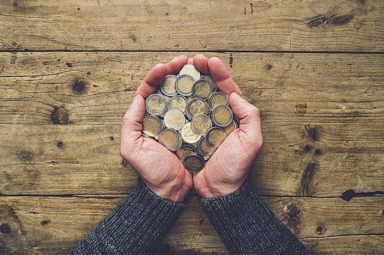 man-holding-euro-coins.jpg