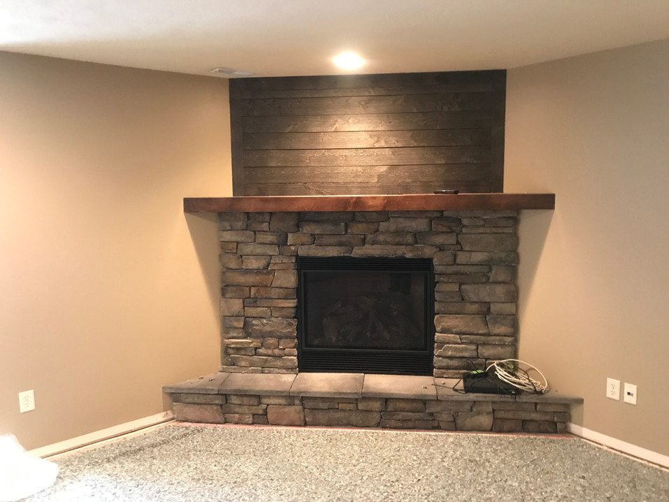 stone fireplace and wood surround.jpeg