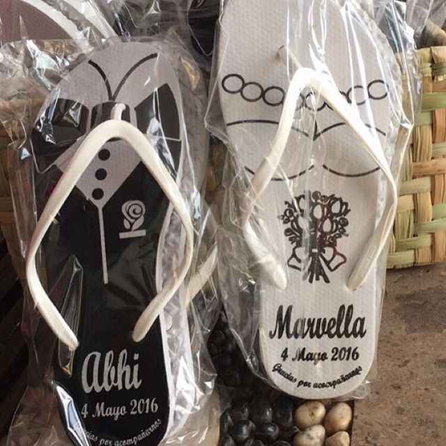 Special touches of custom flip flops for bride & groom to walk in the beach for events
