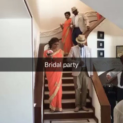 The bridal party make there way down to a live violinist and pianist.  ECEP direct them