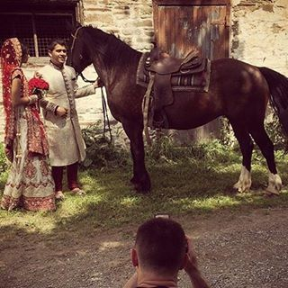 Our B&G doing there creative e-shoot right after they are married #horse #ranch weddinggown