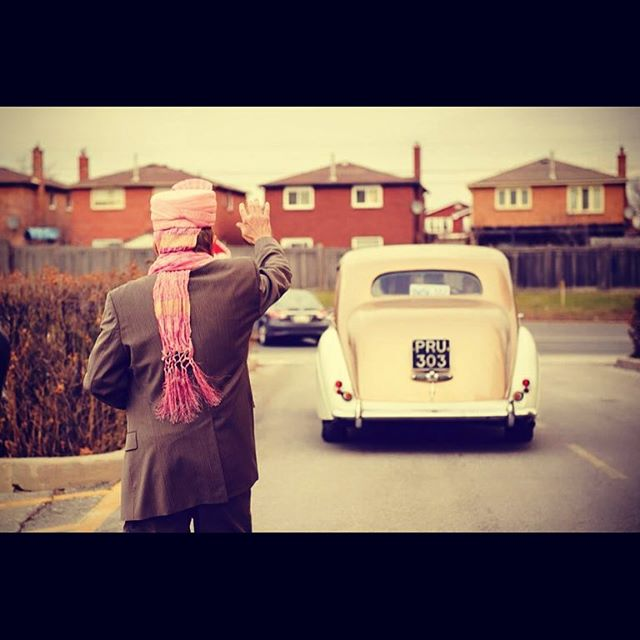 Our adorable client's father waving his goodbyes to his daughter as she becomes Mrs & begins her new