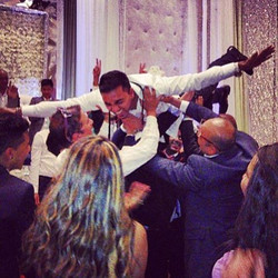 It doesn't get any better then this. Our client crowd surfing on his reception day.