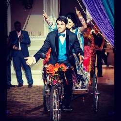 A Surprise grand entrance for the bride & groom on a rickshaw. They wanted something different