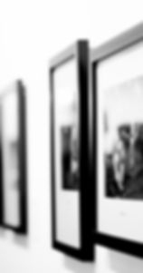 Blac and white custom picture frames hanging on a wall