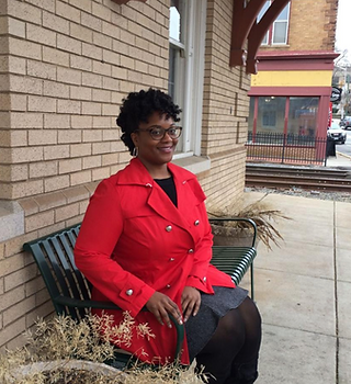 Smiling Black woman in a bright red coat