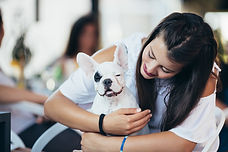 Canva - Woman with dog in cafe.jpg