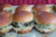 Sliders with sprouts and melted cheese.j
